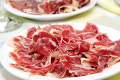 Serrano ham tapas. Closeup of some plates with spanish serrano ham served as tapas Stock Photos