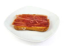 Serrano ham on toasted bread. Jabugo. Spanish tapa. Stock Photos