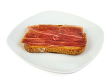 Serrano ham whith bread. Spanish tapa Royalty Free Stock Images