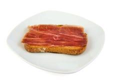 Serrano ham whith bread. Spanish tapa Royalty Free Stock Images