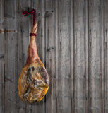 Serrano ham on a wooden plank Stock Photo