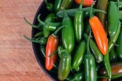 Serrano jalapeno pepper. Serrano and jalapeno pepper crop background royalty free stock photo