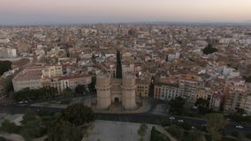 Serranos Towers and Valencia cityscape, aerial shot. Aerial - Ancient Serranos Towers of 14th century with following panorama of Valencia, the third largest city stock video