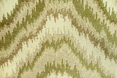 Serrated. Abstract serrated pyramidal background in greens and beige Royalty Free Stock Photography