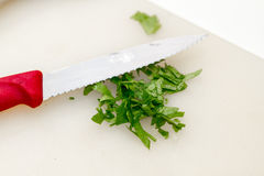 Serrated Knife Chops Parsley Stock Photos