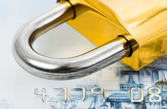 Serratura e carta di credito immagine stock