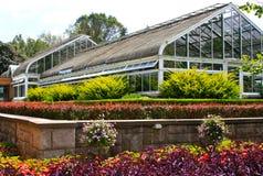 Serre chaude et jardins Photo stock