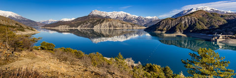 Serre Poncon Lake in Winter, Hautes Alpes, French Alps, France. Panoramic view from hiking trail of Serre Poncon Lake in Winter with snow covered mountains. Le royalty free stock photos