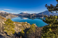 Serre Poncon Lake in Winter, Southern French Alps, France. Serre Poncon Lake from Le Rousset with Winter view on Saint Vincent Les Fort and Le Sauze du Lac. A Stock Photography