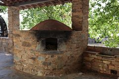 Serta Local Ethnography Communal Wood Fired Oven. View of replica of the communal wood fired masonry oven located at the tilia and oak trees promenade in Serta Stock Photo