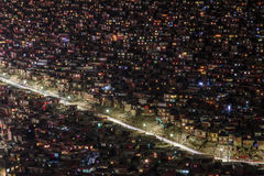 Sertar nightview under destruction. It is a Spectacular Sertar Monastery called Larung Gar Buddhist Academy in China. It is famous of full mountain`s red house Royalty Free Stock Images