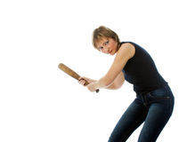 Seruous girl with bat. Serious girl with wooden bat ready to hit the target royalty free stock photos
