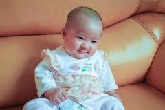 Servalmånader behandla som ett barn leende Royaltyfria Foton