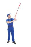 Servant cleaning ceiling over white background Royalty Free Stock Images