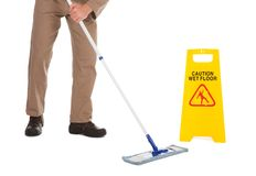 Servant Mopping Floor Over White Background Stock Image
