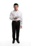 Servant or waiter with empty silver tray. Servant, barman or waiter holding an empty silver tray. Ready for your product if required. White background stock photo