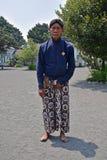 A servant of Yogyakarta Royal Palace Kraton posing in traditional attire Royalty Free Stock Photo