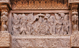 Servants And Admirers Of The Indian God On Carved Wooden Wall Of Traditional Hindu Temple. Stock Photos