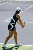 Serve. Woman serving the ball at the professional tennis tournament Royalty Free Stock Images