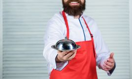 Serve food. Cuisine culinary. man holds kitchen dish tray in restaurant. Healthy food cooking. Mature hipster with beard royalty free stock photos