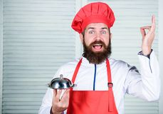 Serve food. Cuisine culinary. man holds kitchen dish tray in restaurant. Healthy food cooking. Mature hipster with beard royalty free stock photo