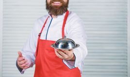 Serve food. Cuisine culinary. man holds kitchen dish tray in restaurant. Healthy food cooking. Mature hipster with beard royalty free stock image
