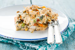Serve the omelet with vegetables and chicken stock image
