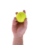 Serve the tennis ball. Hand holding tennis ball ready to serve Royalty Free Stock Photos