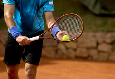 Serve tennis. A tennis player prepares to serve a tennis ball during a match stock image