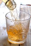 Served aged whiskey splash in glass Royalty Free Stock Images