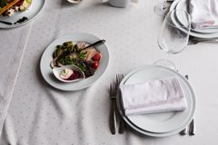 Served for banquet restaurant table with dishes, snack, cutlery, wine and water glasses, european food, selective focus. Served for banquet restaurant table with stock photos