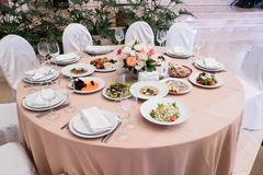 Served for banquet restaurant table with dishes, snack, cutlery, wine and water glasses, european food, selective focus. Served for banquet restaurant table with royalty free stock photos