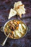Served beef and bean soup. Served beef meat and beans soup with bread,selective focus Royalty Free Stock Image