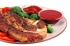 Served beef steak and hot chili sauces Stock Photos