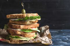 Served big toast sandwich. Big toast sandwich served on the wooden background with blank space,selective focus Royalty Free Stock Photography