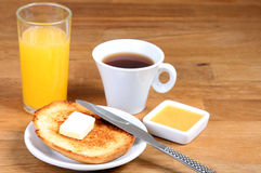 Served breakfast: coffee, toasts with butter, jam and orange juice Stock Photography