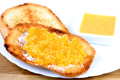 Served breakfast: toasts with butter and orange jam Royalty Free Stock Image