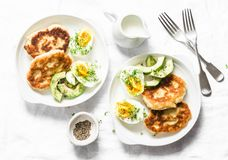 Served brunch table - potato scones and boiled eggs on a light background, top view. Delicious breakfast, snack royalty free stock photo