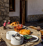 Served buffet table with red wine dishes and silverware Stock Images