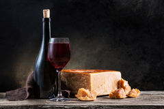 Served cheese and wine. On old wooden table Stock Photos