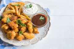 Served chicken nuggets and french fries Stock Photography