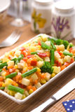 Served chopped vegetables mixture. Potato, green bean, broccoli, corn, carrot, onion and sweet pepper stock photo