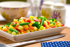 Served chopped vegetables mixture. Potato, green bean, broccoli, corn, carrot, onion and sweet pepper stock images