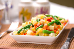 Served chopped vegetables mixture. Potato, green bean, broccoli, corn, carrot, onion and sweet pepper royalty free stock photo