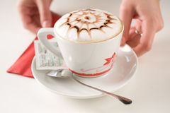 Served coffee. Feed, white mug, silver spoon, fragrant coffee Stock Photography