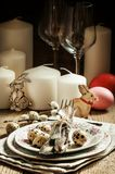 Served for Easter meal old table with plates, eggs and candles,. Selective focus royalty free stock photos