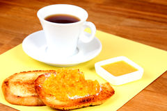 Served european breakfast: cup of coffee, toasts and jam Stock Images