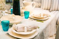 Served fashion table with glases and plates Stock Photography