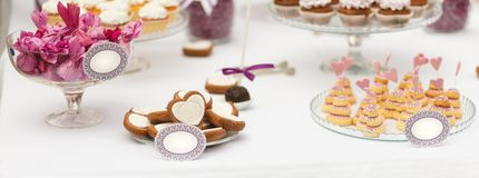 Served festive candy bar table with buiscuits Stock Photo