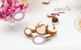 Served festive candy bar table with buiscuits Royalty Free Stock Photos